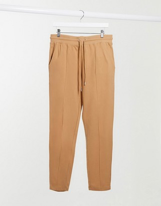 ASOS DESIGN smart co-ord tapered joggers with pintucks in camel brown pique