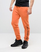 Asos Skinny Joggers With Gothic Text In Orange