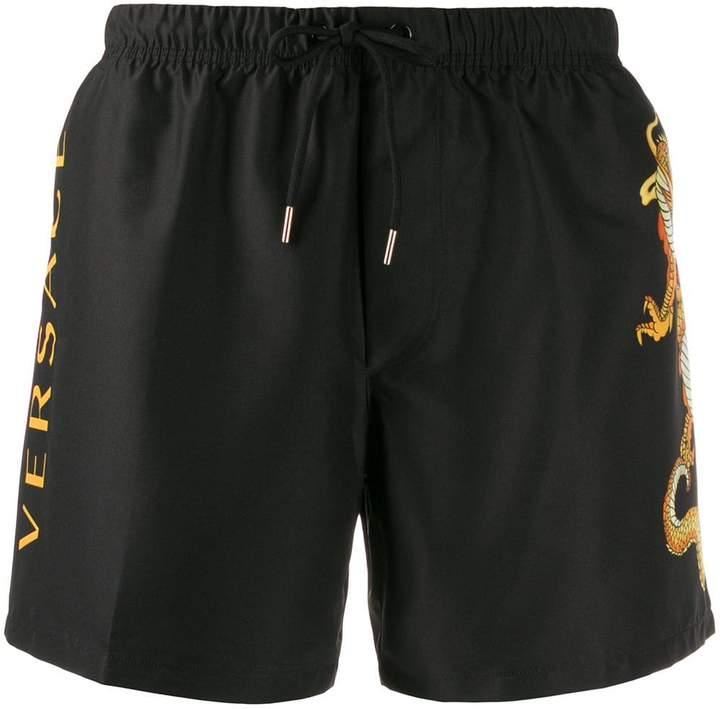 Versace dragon motif swim shorts