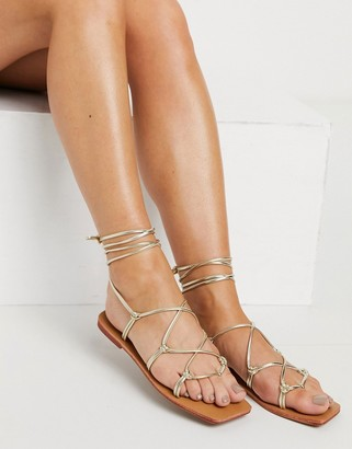 London Rebel square toe strappy tie-up flat sandals in gold