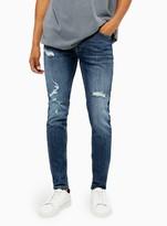 TopmanTopman Ripped Mid Wash Stretch Skinny Jeans