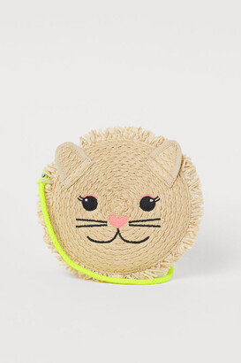 H&M Lion-shaped straw bag