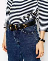 Asos DESIGN vegan tipped jeans belt in water based pu