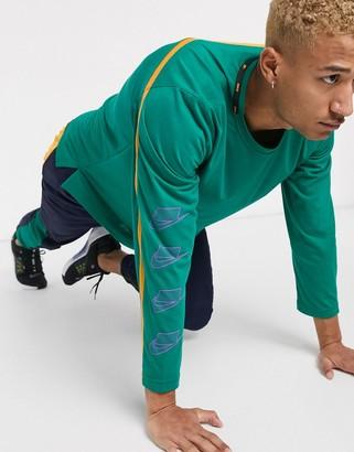 Nike Training sport pack long sleeve top in green