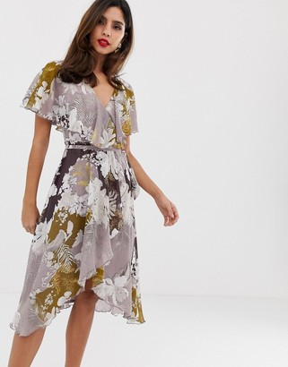 ASOS DESIGN midi dress with cape back and dipped hem in patchwork floral