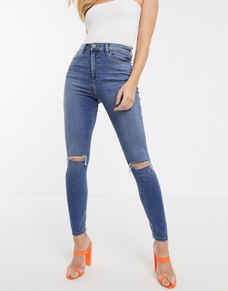 ASOS DESIGN high rise ridley 'skinny' jeans in mid vintage wash with slash rip knee detail