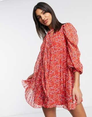 ASOS DESIGN pleated trapeze dobby mini dress with neck tie in red ditsy floral print