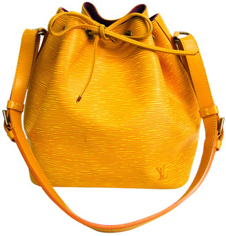 Louis Vuitton NoA Yellow Leather Handbags