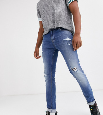ASOS DESIGN Tall skinny jeans in mid wash blue with rips and destroy