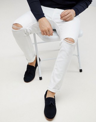 Asos Design DESIGN skinny jeans in white with knee rips