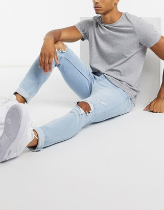 Topman skinny jeans with blowout rips in light wash blue