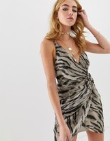 Asos Design DESIGN mini dress with horn buckle detail in abstract animal