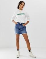Only vintage wash destroyed denim mini skirt
