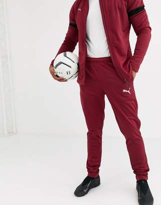 Puma Football tracksuit in burgundy with black panels exclusive to ASOS-Red