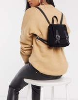 Asos Design DESIGN SUEDE backpack with buckles