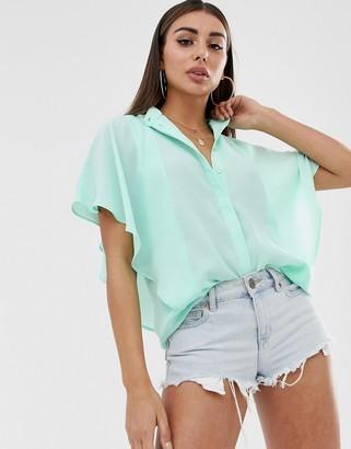 Asos Design DESIGN sleeveless soft shirt with ruffle detail-Green