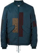Oamc patchwork design bomber jacket - men - Polyamide/Polyurethane/Cupro/Virgin Wool - M