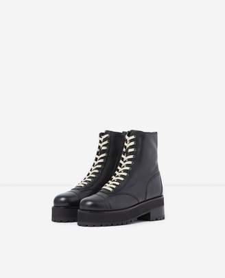 The Kooples Black leather ankle boots with notched soles