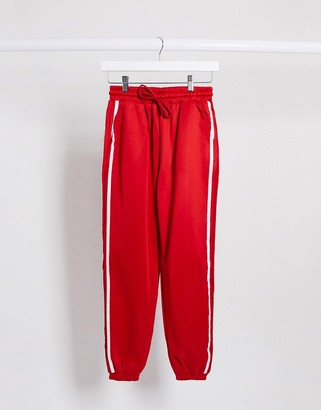 The Couture Club stripe side seam detail oversized joggers in red