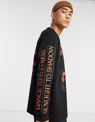 ASOS loose fit long sleeve t-shirt in black with text print