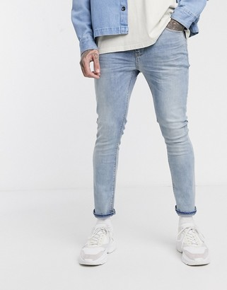 ASOS DESIGN cropped super skinny jeans in light wash blue