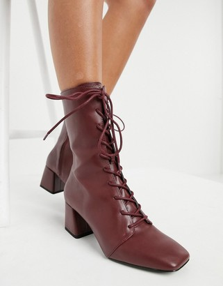 Monki Thelma faux leather lace up heeled boots in burgundy