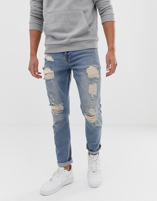Asos Design DESIGN stretch slim jeans in vintage light wash blue with heavy rips