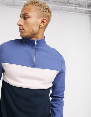 ASOS DESIGN half zip sweatshirt with color block panels in blue and pink