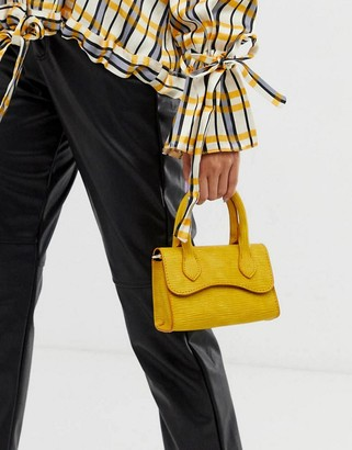 Asos Design DESIGN micro grab bag with curved flap and detachable strap-Yellow
