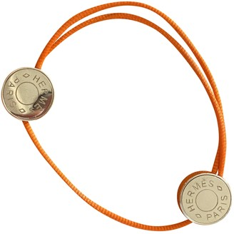 Hermã ̈S HermAs Orange Metal Bracelets