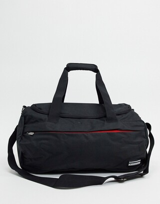 Ben Sherman roll bag in black and red