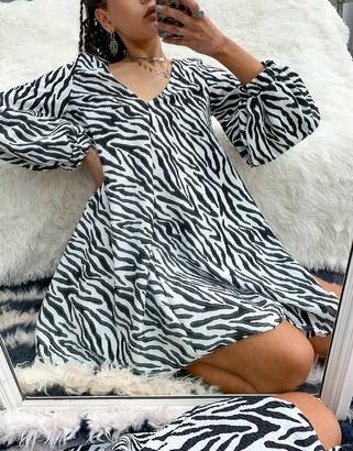 ASOS DESIGN textured mini v-neck swing dress in zebra print