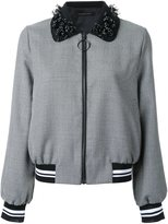 Mother of Pearl houndstooth pattern bomber jacket