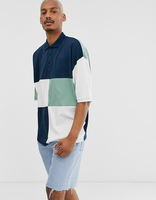 Asos Design DESIGN oversized longline polo shirt with half sleeve and patchwork color block in navy