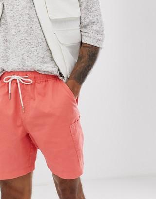 Asos DESIGN slim shorts in washed pink with cargo pocket