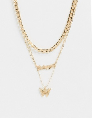 ASOS DESIGN multirow necklace with gothic babygirl and butterfly pendants in gold tone