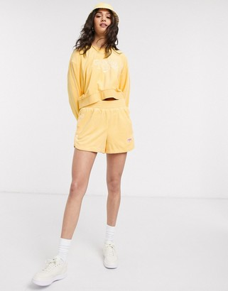 Nike terry towelling shorts in yellow