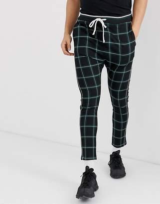 Bershka trousers with green check and elastic waist-Black
