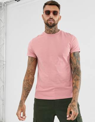 Asos Design DESIGN t-shirt with crew neck and roll sleeve in pink