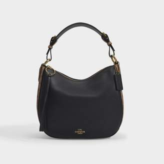 Coach Sutton Hobo Bag In Tan And Black Signature Coated Canvas