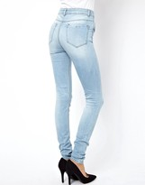 Asos Ridley High Waist Ultra Skinny Jeans in Ice Blue with Ripped Knee