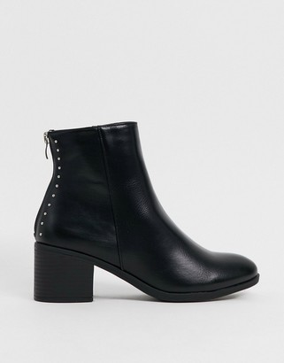 Truffle Collection faux leather mid heeled ankle boots in black with back detail