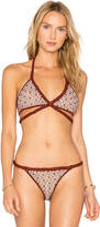 For Love & Lemons Samba Braided Halter Top in Rust. - size L (also in M,S,XS)