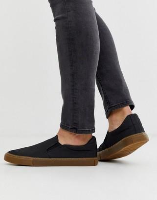 Asos DESIGN slip on plimsolls in black with gum sole