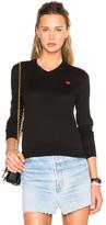 Comme des Garcons Small Emblem V Neck Sweater in Black.