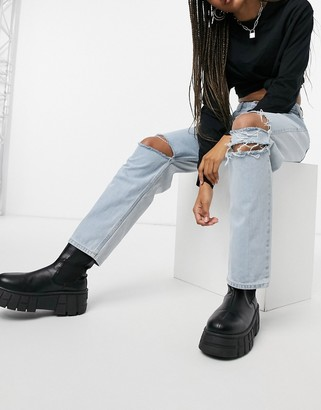 Kikiriki two-tone relaxed jeans with bleach back and knee rips