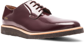 Common Projects Derby Leather Shine in Oxblood | FWRD