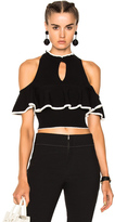 Apiece Apart Knit Cold Shoulder Ruffle Top in Black.