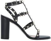 Valentino Garavani Rockstud cage-effect strap sandals