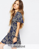 Reclaimed Vintage Button Front Mini Tea Dress With Ruffle Detail In Paisley Print